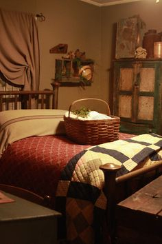 Prim Bedroom...with old quilts & pie safe...love the curtain!