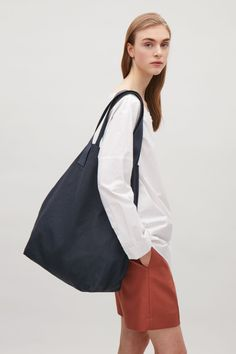 COS image 6 of Large canvas bag in Navy