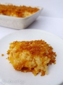 Everybody's Favorite Cheesy Hashbrown Bake - Everyone loves the combination of perfectly browned potatoes and shredded cheese. Add in some onion, cream of chicken soup and sour cream and you have a winning casserole recipe!