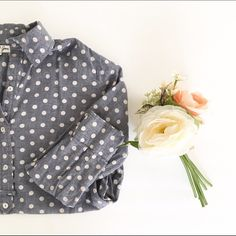 Denim polka dot top Halfway button up shirt with collar and sleeve buttons. Backside is longer than the front. Jennifer and Grace  Tops Button Down Shirts