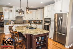 Kitchen Remodel by the Kaz Companies in Orchard Park, NY. Haas Cabinets - Estate Double Panel Maple Cabinets, Bistro Smoke Finish. Island - Estate Maple Cabinets, Bombay Finish. Granite Crystal Canyon Countertop, Glass Backsplash, Smoked Pearl from Daltile