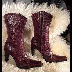 Steve Madden heeled boots. Run small. These beauties are handcrafted leather upper. Burgundy not red.I tried my best to show their true color. The only flaw is shown in last picture. But still fabulous. Only too tight for me. RUN SMALL. Brisa. More pictures are available in another post. Please make sure to see them before you buy. Steve Madden Shoes Heeled Boots