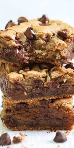 These Best Chocolate Chip Cookie Bars are chewy and richly sweet. Swimming in chocolate chips, you are going to love this simply delicious chocolaty treat. #simplyhomecooked #cookie #cookiebars #dessert #dessertbars