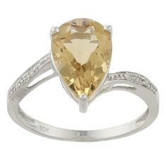 This gorgeous ring sparkles with a unique citrine center stone. The 12x8mm pear-shaped citrine is accented by white diamonds down the shank. The jewelry is crafted of gleaming 10-karat white gold in a highly polished finish. November birthstone.