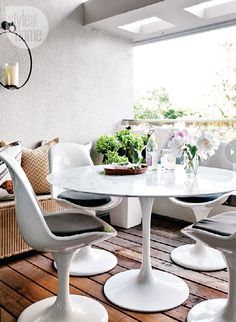 A marble-topped table keeps this balcony feeling indoorsy and makes a lovely outdoor living space. {PHOTO: Donna Griffith}