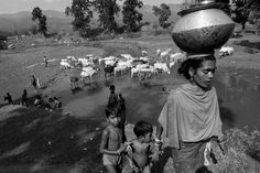 Pattabi Raman's photo essay on working mothers in parts of rural India illuminates the challenges and struggles many working mothers around the world face, and highlights issues that are specific to women in parts of rural India, such as the threat of displacement due to industrialization.