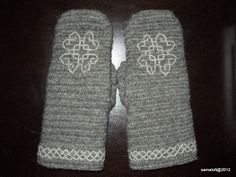 """These gray nalbound mittens with embroidery in Holbein stitch, were made in Brodén Stitch UOOO/UUUOO, F1 (aka suomeksi 1+3). In the neighbouring country Sweden this nalbinding stitch was made well-known by Märta Brodén when she wrote her Nålbindning book in the 1970's, but this stitch type has been known here in Finland as well."""