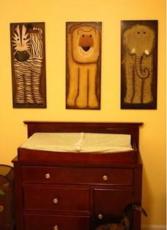M J's Changing Table and Safari Wall Art: As you can see from M J's safari nursery theme pictures, our baby girl's room has a blend of tropical and wild animal print fabrics including the nursery