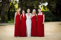 Gorgeous red bridesmaid dresses for Spanish style wedding in Sevilla with photos by Limelight photography | junebugweddings.com