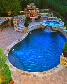 In ground pool with hot tub/water fall and fireplace. Pretty much exactly what I want.