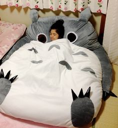 Big Totoro Sleeping Bag. Definately want to get one of these from a small age...just imagine the little girl from the film laying on it :) from Wish.com