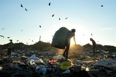 Children collect waste at a landfill in Managua, Nicaragua, Sept. 20, 2012.