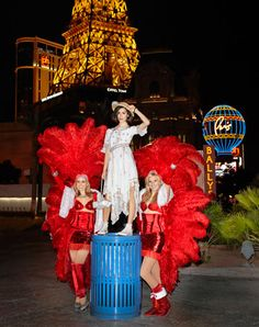 A Fashionable Life: Gia Coppola's Vegas  Life is a cabaret. Gia redefines the cancan with a duo of local showgirls while in Vegas for a Chanel exhibition. Chanel Paris-Bombay dress and bag. 800-550-0005. Albertus Swanepoel hat. Cartier watch. Gia's own Converse.