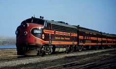 """#156 Chicago & Great Western Electro-Motive F7 A unit on the front end of """"Mill City Limited"""" Leavenworth, Kansas 1954"""