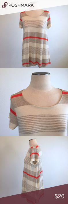 """Puella- Oatmeal/Orange Stripe Jersey Swing Tee XS Puella- Oatmeal/Orange Stripe Jersey Swing Tee XS. Super soft and comfy. 62% Polyester, 33% Rayon, 5% Spandex. Loose fit, swing style. Preloved but still great condition. No holes, stains, tears, all seams intact. Shoulder-hem measures about 27"""" long. Armpit-armpit measures about 19"""" across. Puella Tops Tees - Short Sleeve"""