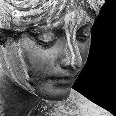 Woman Looking Down at Grave, Père Lachaise Cemetery, Paris.  Copyright 2015 Michael McLaughlin.