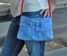 Hand Made Original recycled denim bag made from toddler jeans this little bag is  10 wide 7 tall and lined in red fabric. The strap is 41 long and can go across the body or over the shoulder. Velcro closer to help keep your electronic device, keys or glasses safe.  There are the original 5 pockets; admittedly the back pockets are tiny.  Key tab is on the left side of bag. Tuck the strap in and you have a clutch. Easy care machine wash and dry.