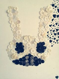 K-Pop wall art. Gaaah I wanna do this!! Could also sew the buttons to a pillow or shirt