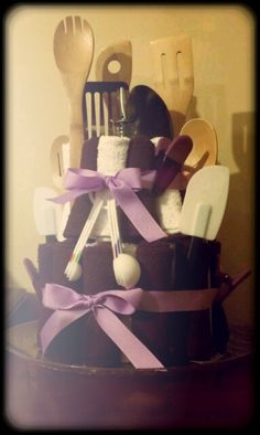 """Kitchen utensil towel """"cake"""".  This would make a really good house warming gift.!"""