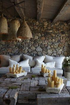 rustic, stone wall, candles, plush sofa, living room,