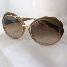 M A R N I Very rare M A R N I sunglasses. Big Round Lenses. Beautiful Brushed gold-tone accents. Excellent condition. Will Come with a new dust cloth and in a sturdy hard case . MARNI Accessories