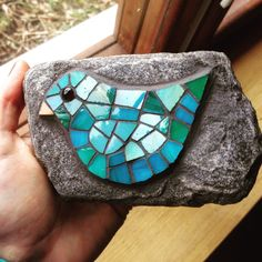 A little green and blue bird mosaic