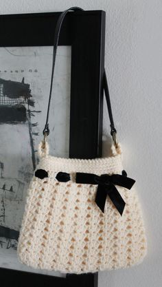 This child-size crochet hobo purse was super fun to make; probably because I got to use my new sewing machine. Yea! The pattern was inspired by a purse that sold at Nordstrom's around 2003. T…