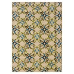 Anchor your patio seating group or define space in the den with this woven indoor/outdoor rug, featuring an eye-catching tile motif for chic style.