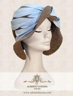 Alberto Lusona Fall/Winter Collection 2013 - Beige wool boiled hat in retro style with light blue leafs in the same material. $120    #albertolusona #boiledwool #eleganthat #retrostyle #clochehat