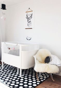 black and white nursery / #sheepskin, polka dot rug, eames