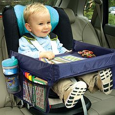 Product # 62283 - The ideal tray to keep kids entertained in the car. Adjustable back straps keeps soft, foam lined tray secure around child in a car seat. High sides keep things from falling out. Mesh side pockets to hold crayons or sippy cups. Strong wipe clean nylon cover is ready for any mess. Folds for storage.
