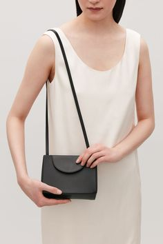 A sleek, structured style, this small shoulder bag is made from smooth leather. Designed to be worn short over the shoulder or long across the body, it has a hidden magnetic closure and an adjustable strap. 14 x 18 x Luxury Handbags, Fashion Handbags, Fashion Bags, Women's Fashion, Fashion Accessories, Small Shoulder Bag, Leather Shoulder Bag, Leather Handbags, Leather Bag