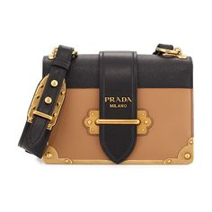 "Cahier Notebook Shoulder Bag by Prada. Prada colorblock saffiano and smooth leather shoulder bag. Bronze hardware. Adjustable shoulder strap, 18.5"" drop. Flap top with buckle closure. Metal logo lettering on flap. Interior, one flap and one slip pocket. Napa leather lining. 5... #prada #bags"