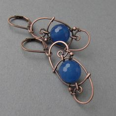 Copper with blue ball by ggagatka... I would make links for a chain this way... Not so sure about the earrings though