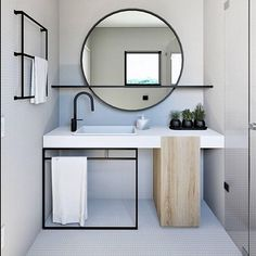 love the color scheme of this shower - white counter, black faucet, black accents around mirror