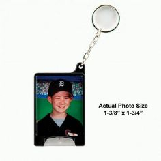"""Photo Flashlight Keychain is great for any photo. The light makes it easy to find locks at night and the batteries can be replaced.  Available in silver or black  Photo Included  Actual Photo Size 1-3/8"""" x 1-3/4"""""""