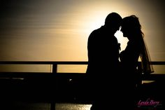 I LOVE this shot for a beach wedding - silhouette of the couple at sunset. A must-have to ask your photographer for. | Lynda Berry Photography