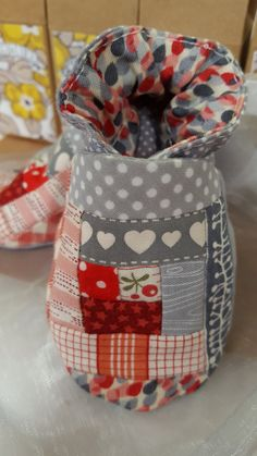 Beautiful fussy cutting and log cabin patchwork.  Piecedd by hand. Unique baby shoes.  Check out this item in my Etsy shop https://www.etsy.com/uk/listing/259402236/hand-sewn-log-cabin-baby-booties-red-and