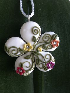 Handmade polymer clay multicolored flowershaped by MiniCose