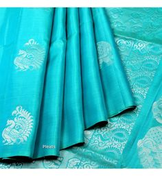 Grab online bright blue soft silk saree made of finest silk & designed with motif's styling apptern all over that gives rich pallu, suitable for special & other occasions. Sky Blue Saree, Blue Silk Saree, Indian Silk Sarees, Silk Cotton Sarees, Silk Sarees With Price, Silk Sarees Online, Fancy Blouse Designs, Saree Blouse Designs, Blue Bridesmaid Dresses Short