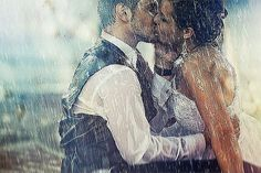 The ultimate wedding kiss in the rain / trash the dress photoshoot