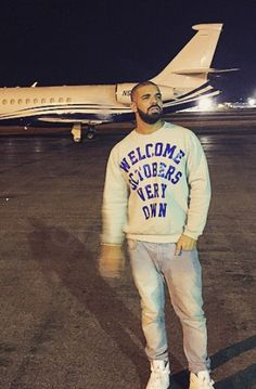 Drake Waiting at the airport wearing octobers very own sweater