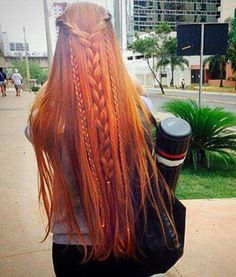 Beautiful long red hair and braid