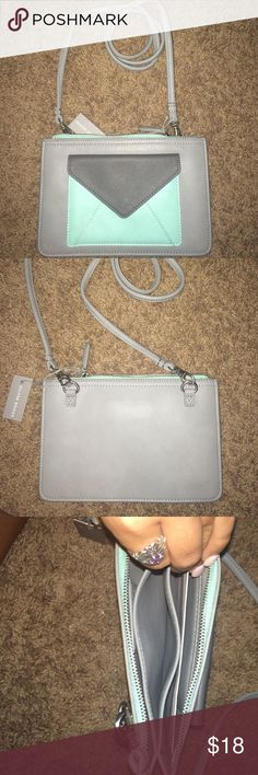 Cross body purse Never used!! Still has tag. Strap can be taken off and put on Oliver bonas Bags Crossbody Bags