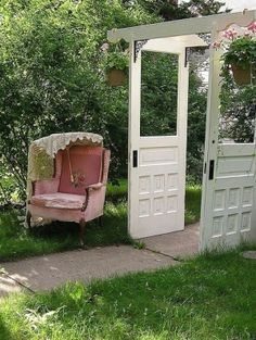 Oh So Shabby by Debbie Reynolds Doors used in the garden trellis with cute pink chair by 34ford