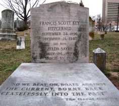 The grave of F. Scott and Zelda Fitzgerald engraved with a quote from Scott's novel The great Gatsby so we beat on, boats against the current, borne back ceaselessly in to the past.