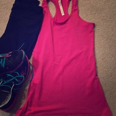 lululemon tank Bold hot pink tank by lululemon athletica. Cool racerback. Sweat wicking technology. Scoop neck & racer back. No built in bra. In excellent used condition-practically new, breakaway tag still attached! Size 12. lululemon athletica Tops Tank Tops