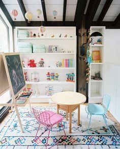 A hand-knotted rug and mobile of hot air balloons add fun pops of color to this play space.