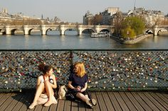 Visit the Pont des Arts - lovers put a padlock with their initials on the bridge and toss the key into the river, ensuring their lock remains on the bridge forever.