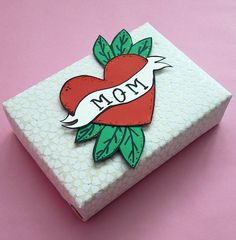 Mom Tattoo - Mother\'s Day 2018  | Visit ginnysgiftwrap.com to learn more about NYC\'s premier gift wrapping service!  #ginnysgiftqwrap #giftwrappingservice #giftwrappingideas #wrappingpaper #papercraft #diygiftwrapping #giftsformom #giftsforher